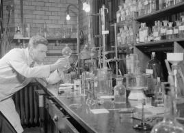 Penicillin Past, Present and Future- the Development and Production of Penicillin, England, 1944 Dr Wilson Baker hard at work in the Dyson-Perrins' laboratory, Oxford. Dr Baker has been working with Professor Sir Robert Robinson and others to try to create synthetic penicillin. He has just succeeded in breaking down penicillin into its separate elements and it is now a question of discovering the correct way to put these together to create a synthetic copy of the natural mould. Imperial War Museum